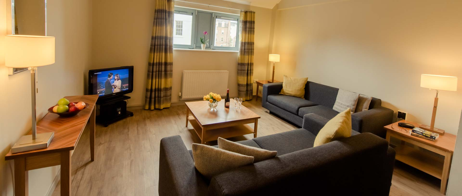 The lounge area in PREMIER SUITES Newcastle serviced apartments