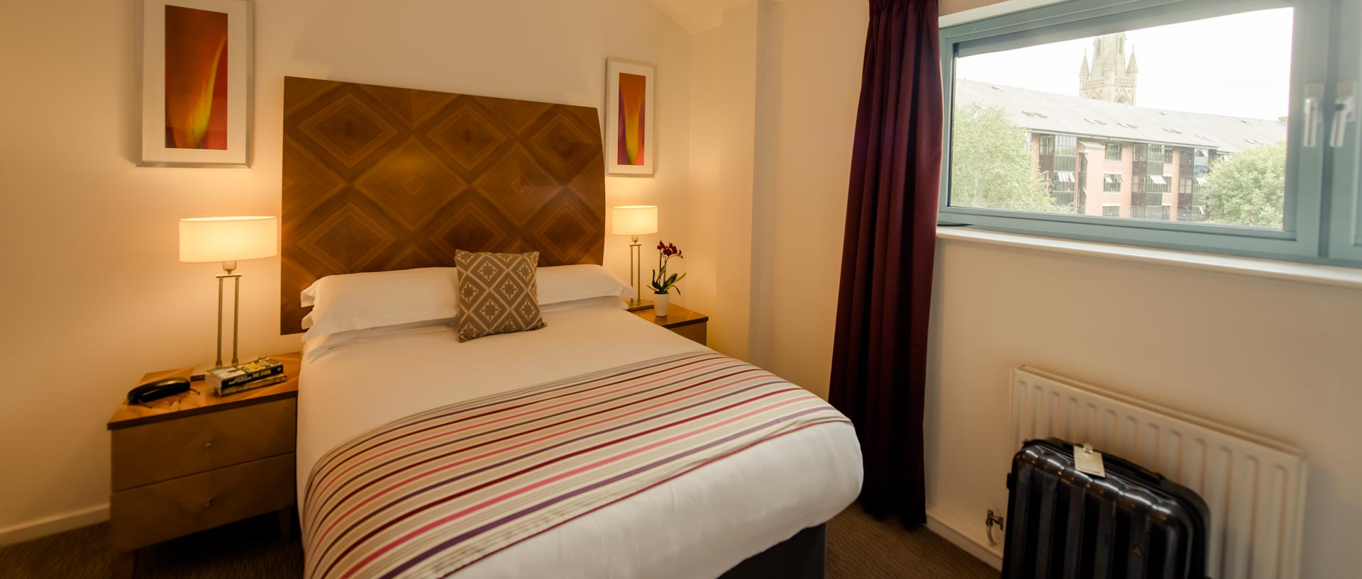 Modern double bed in PREMIER SUITES Newcastle serviced apartments
