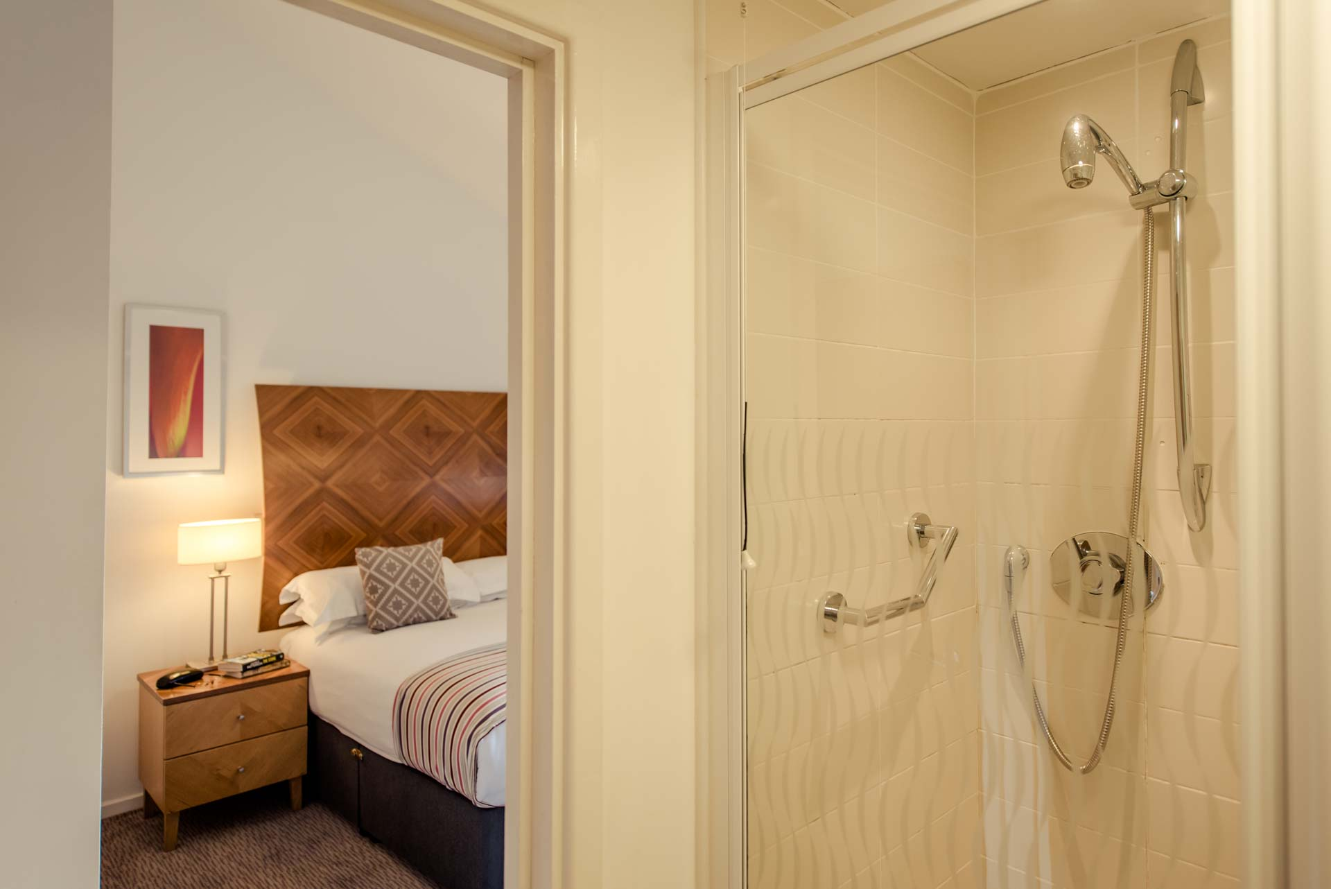 PREMIER SUITES Newcastle double bed view from ensuite bathroom